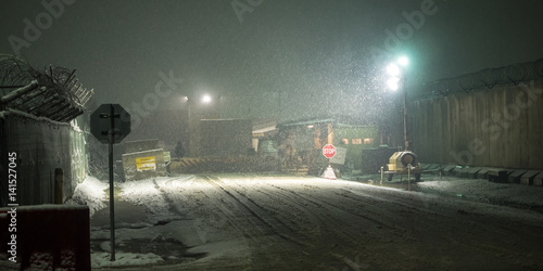 Guard Gate on Military Installation in Afghanistan during snow at Night Wallpaper Mural