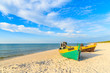 Colorful fishing boats on sandy Debki beach during sunny summer day, Baltic Sea, Poland