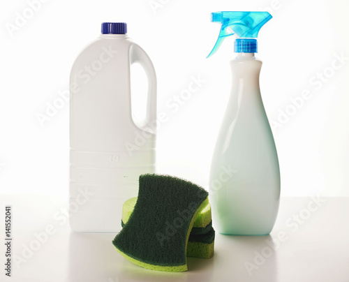 Fotografie, Obraz  The bottles with cleaning chemistry and green sponges.