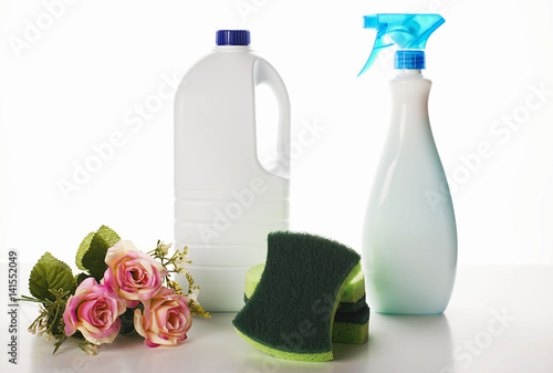 Fotografie, Obraz  Small bunch of flowers placed near the cleaning chemistry bottles and sponges
