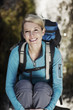 Portrait of female hiker, waterfall in background