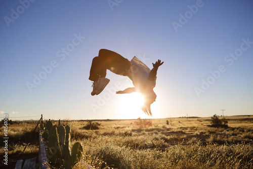 Young man doing somersault