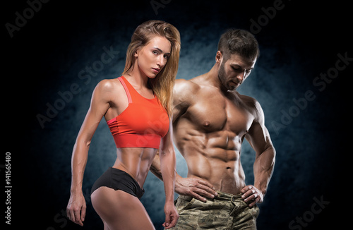 Spoed Foto op Canvas Fitness Athletic man and woman. Fitness couple.