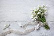 Bouquet of snowdrops on a white wooden background