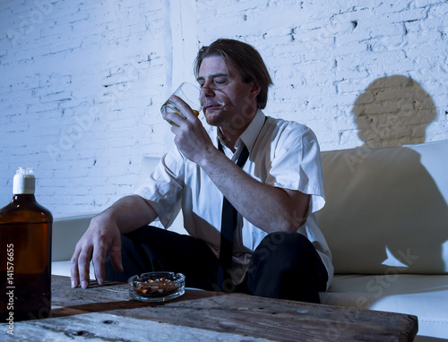 Fotografía  depressed alcoholic businessman with loose necktie wasted and drunk drinking whi