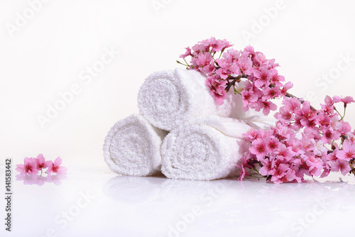 Tropical Spa with blooming branch with towel