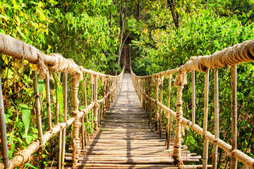 Fototapeta Bambus Scenic simple suspension bridge over gorge