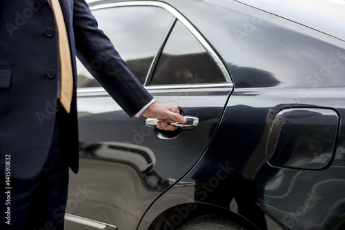 Photographie  Businessman Handle Limousine Door Car