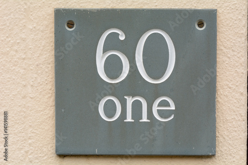 Photo  House number 61 sign on wall