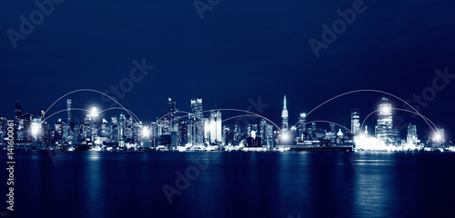 Fototapeten New York Network and Connection Technology Concept of New York City Skyline at night, USA