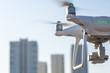 Dron, quadrocopter.
