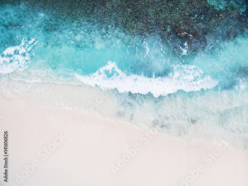 Montage in der Fensternische Luftaufnahme Beautiful tropical white empty beach and sea waves seen from above. Seychelles Grand Anse beach aerial view