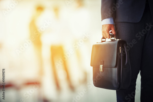 businessman holding his briefcase in office Canvas Print