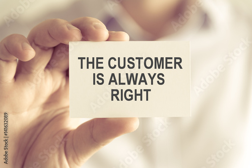 Businessman holding THE CUSTOMER IS ALWAYS RIGHT message card Wallpaper Mural