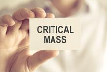 Businessman Holding CRITICAL MASS Message Card