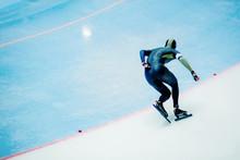 Male Athlete Speed Skater On Turn Ice Arena