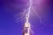 Leinwandbild Motiv top of church tower with lightning