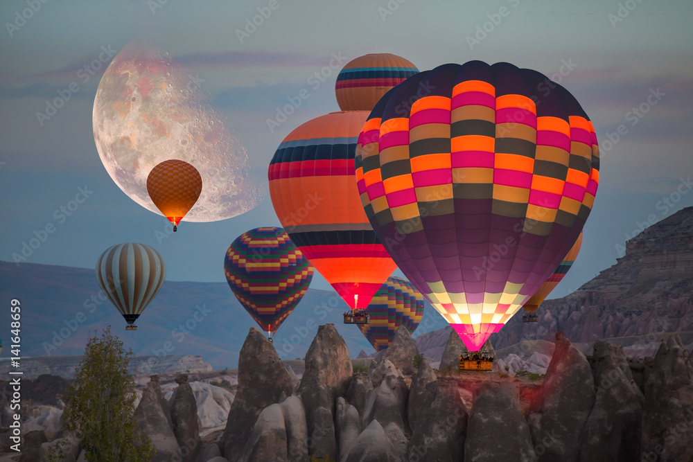 Fototapety, obrazy: Hot air balloon flying over spectacular Cappadocia