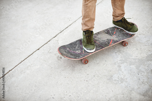 Close-up of skateboarders foot while skating in skate park Canvas Print