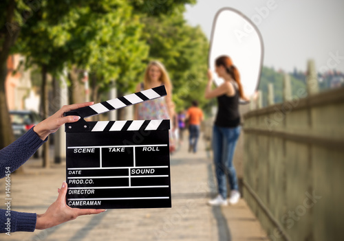 Valokuvatapetti Clapperboard sign hold by female hands.