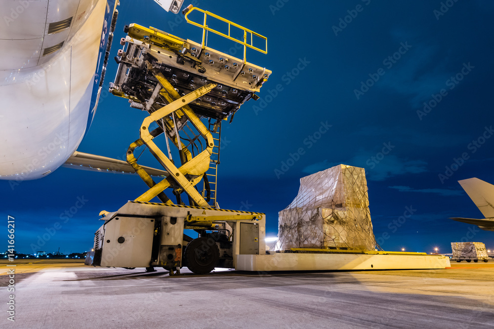 Fototapety, obrazy: Loading cargo on the plane at airport, twilight time