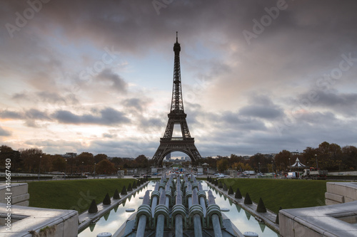Eiffel Tower and Trocadero Fountain against cloudy sky during sunset