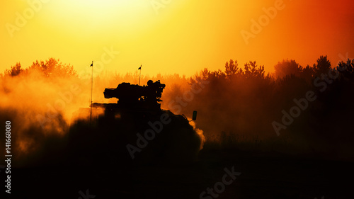 Wall Murals Beautiful morning ARMORED INFANTRY FIGHTING VEHICLE - military vehicle in the forest at sunset