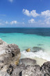 Scenery from the Caribbean sea shore. Beautiful beach with small waves.