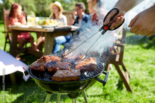 Fotografie, Obraz  man cooking meat on barbecue grill at summer party