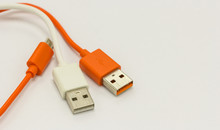 USB Cables For Charger Or Connection Different Technology Devices On White Background.