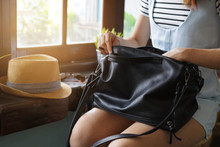 Young Woman Looking For Something In Her Purse
