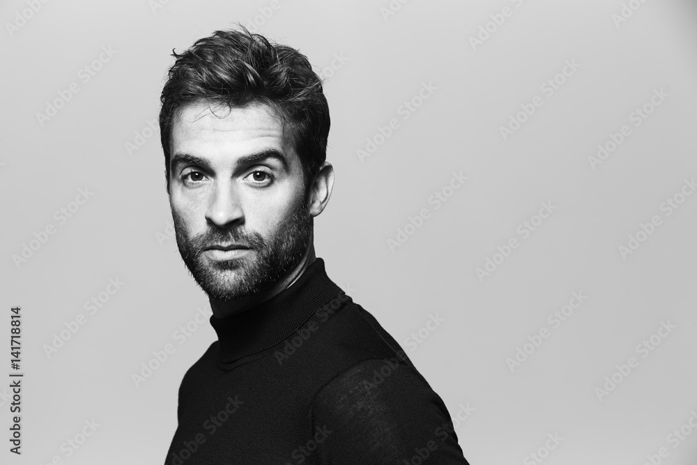 Fototapeta Seriously handsome man in studio