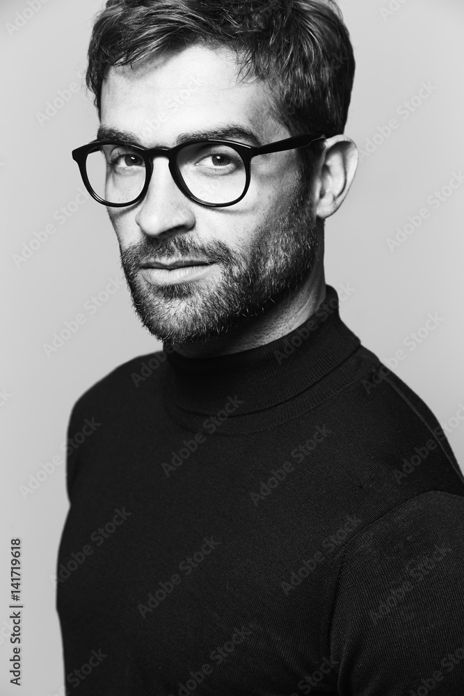 Man in spectacles looking at camera