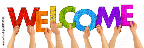 Stampa su Tela  People holding up colorful letters shaping the word welcome concept background i