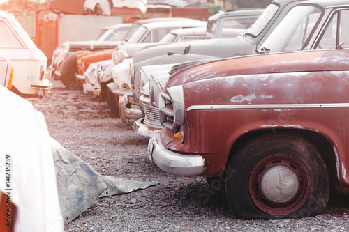 rows of cars in a salvage yard facing each other Canvas Print