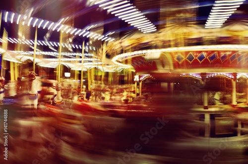 Obraz na plátně  Blur of Speed on Merry-Go-Round