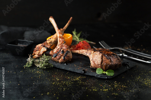 Grilled lamb rack with spices and sauce