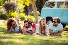Happy Friends Lying On Grass T...