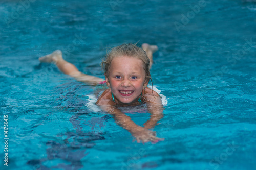 111fca2fd8 Little girl learning to swim in big sport pool. Swimming school for small  children.