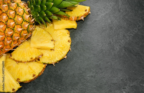 Pineapple on stone background with copy space