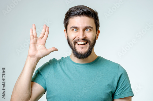 Fototapeta Man making Vulcan salute isolated