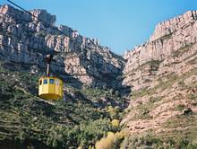 Cliffs And Yellow Cable Car