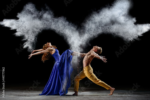 Dance duet with the powder mixtures in the dark. Poster