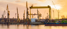 Silhouettes Of Cranes And Cranes In An Industrial Area After A Former Shipyard In Szczcecin, Now Revitalized