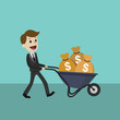 Happy businessman or manager goes with a wheelbarrow full of cash