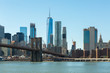 View of Brooklyn Bridge and Manhattan skyline WTC Freedom Tower from Dumbo, Brooklyn. Brooklyn Bridge is one of the oldest suspension bridges in the USA