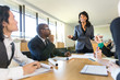 Female executive employee coworker showing confidence in leadership at roundtable discussion