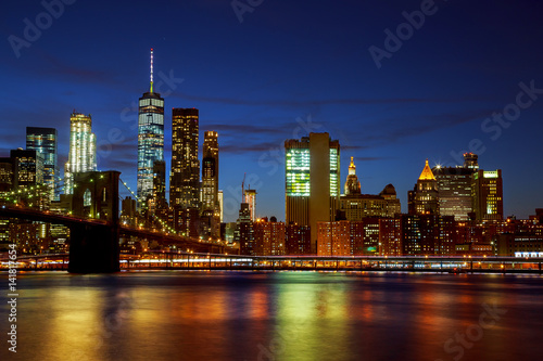 New York City's Brooklyn Bridge and Manhattan skyline illuminated