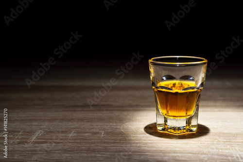 Fotobehang Alcohol whisky shot drinks, Alcohol shots, Scotch and alcohol, alcoholic drinks, alcohol glasses top view, alcohol glasses of whiskey, alcoholic drink with ice on a glass.