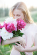 canvas print picture - blonde girl with summer bouquet, peonies